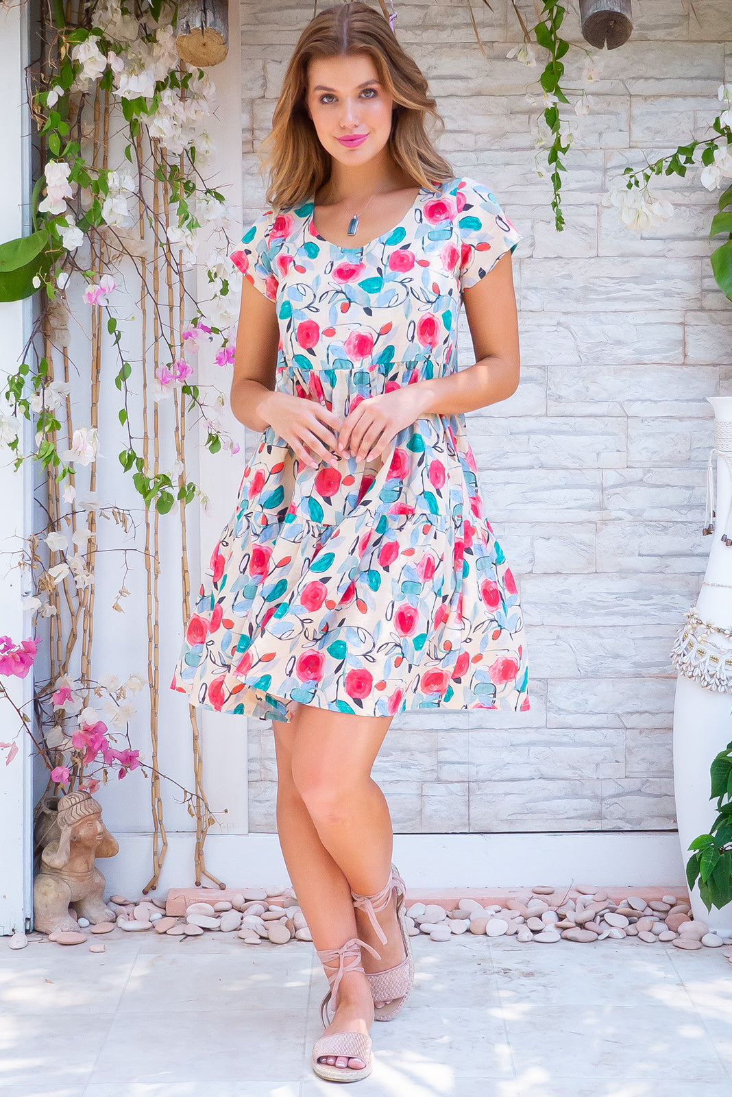 Lulu Elle Retro Roses Mini Dress, bohemian summer style, 100% cotton, slightly sheer, side pockets, tiered skirt, sandy beige base with medium magenta, blue and teal rose print.