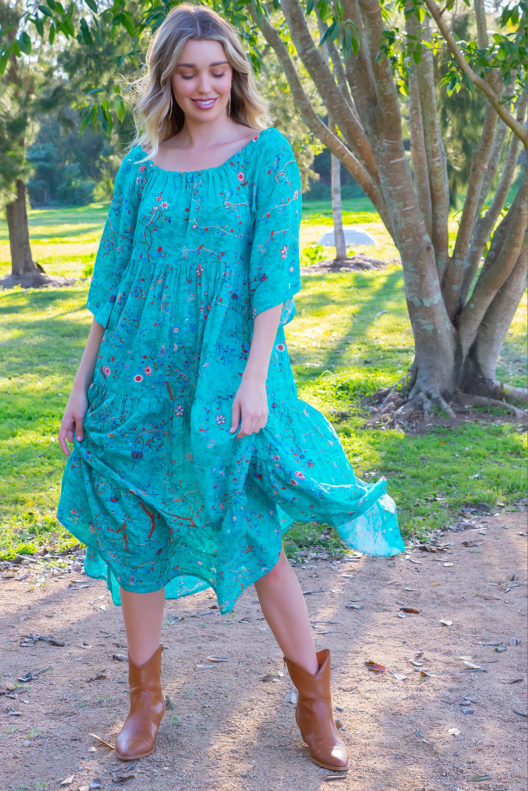 Lulu Liberty Aquamarine Dream Swing Maxi Dress features a bohemian inspired tiered skirt, adjustable neckline which can be worn off the shoulder, a fabric waist belt and beautiful bright cotton fabric in a dainty floral print.