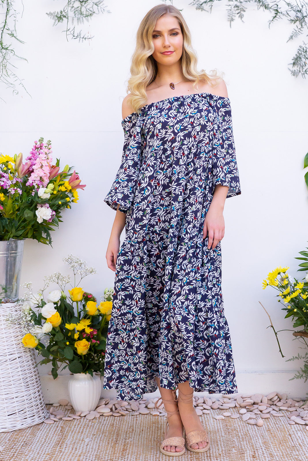 Lulu Liberty Navy Bird Maxi Swing Dress is a summer staple for this year. Navy base with a bird and leaf print on rayon/cotton blend fabric. Includes waist tie for belt and adjustable neckline can be worn on or off shoulder.