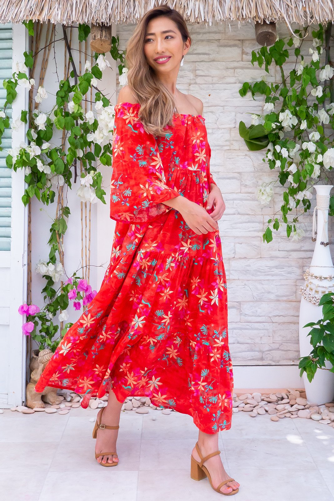 Lulu Liberty Rad Red Maxi Swing Dress can be worn 2 ways, off the shoulder style and on top of shoulders in scooped neck style having side pockets in bold vermillion orange/red with pink, green and yellow floral woven 100% cotton and fabric belt included to cinch in waist.
