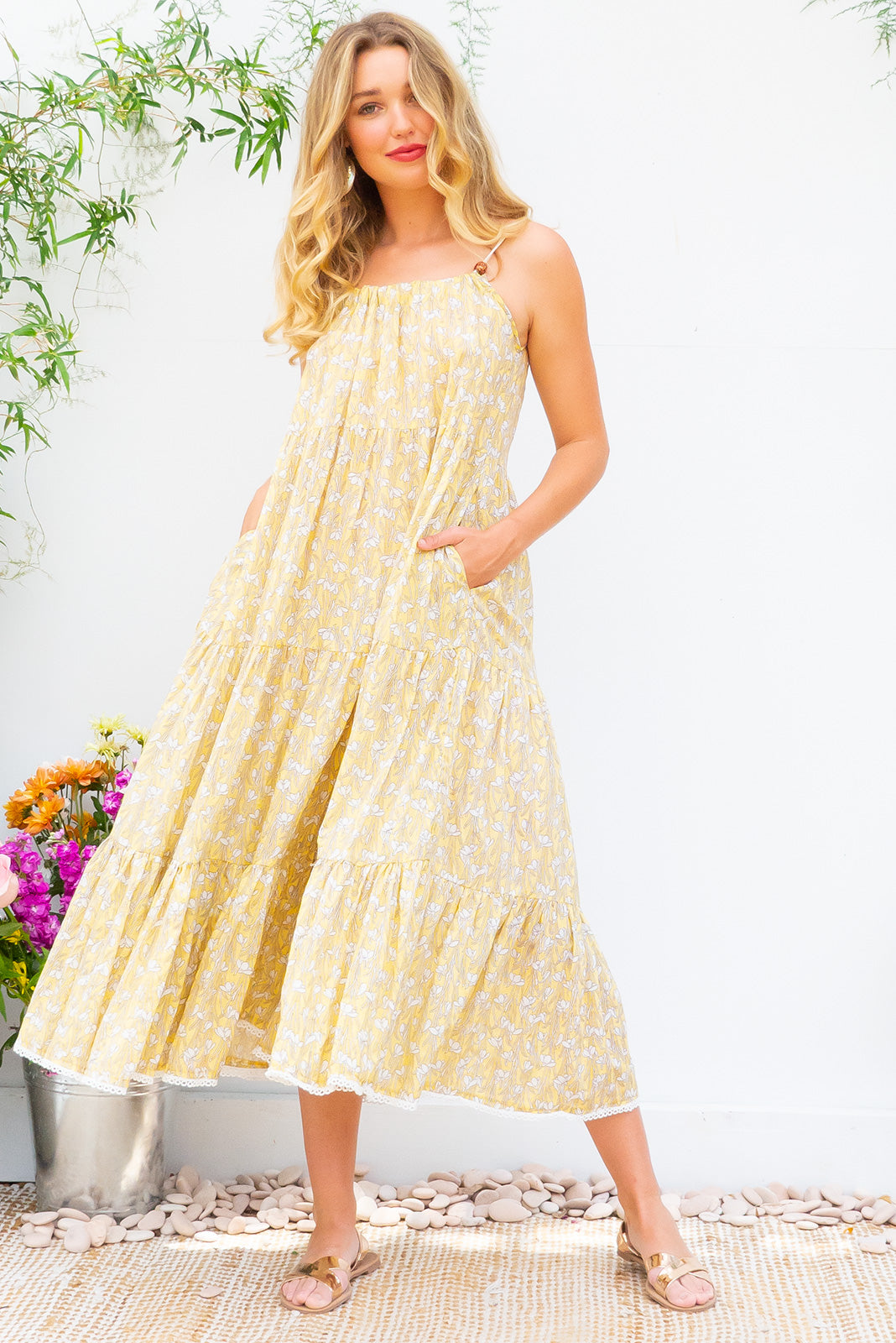 Lulu Loves Snowdrop Sunshine Maxi length cotton rayon blend tiered dress with a adjustable neckline, side pockets in beautiful light yellow and white snowdrop floral print on 100% cotton, comes with a self coloured belts and features side pockets