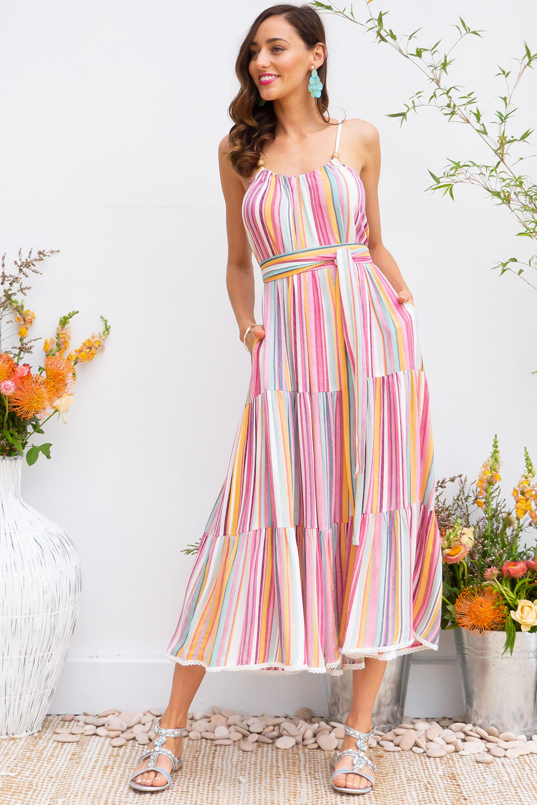 Lulu Loves Super Stripe Maxi length crinkle rayon tiered dress with a adjustable neckline, side pockets in a gorgeous warm toned stripe print