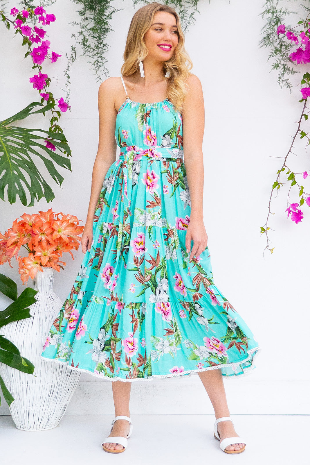 Lulu Loves Tropical Turquoise Maxi length rayon tiered dress with a adjustable neckline, side pockets in a gorgeous bright aqua green colour with tropical inspired floral print