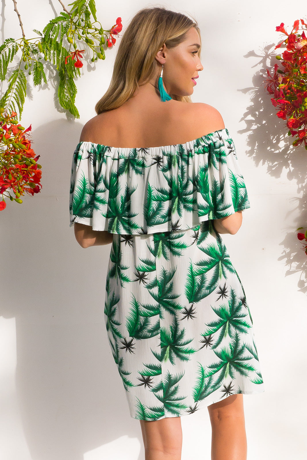 Macarena off the shoulder mini dress in a tropical green palms print on soft crinkled rayon