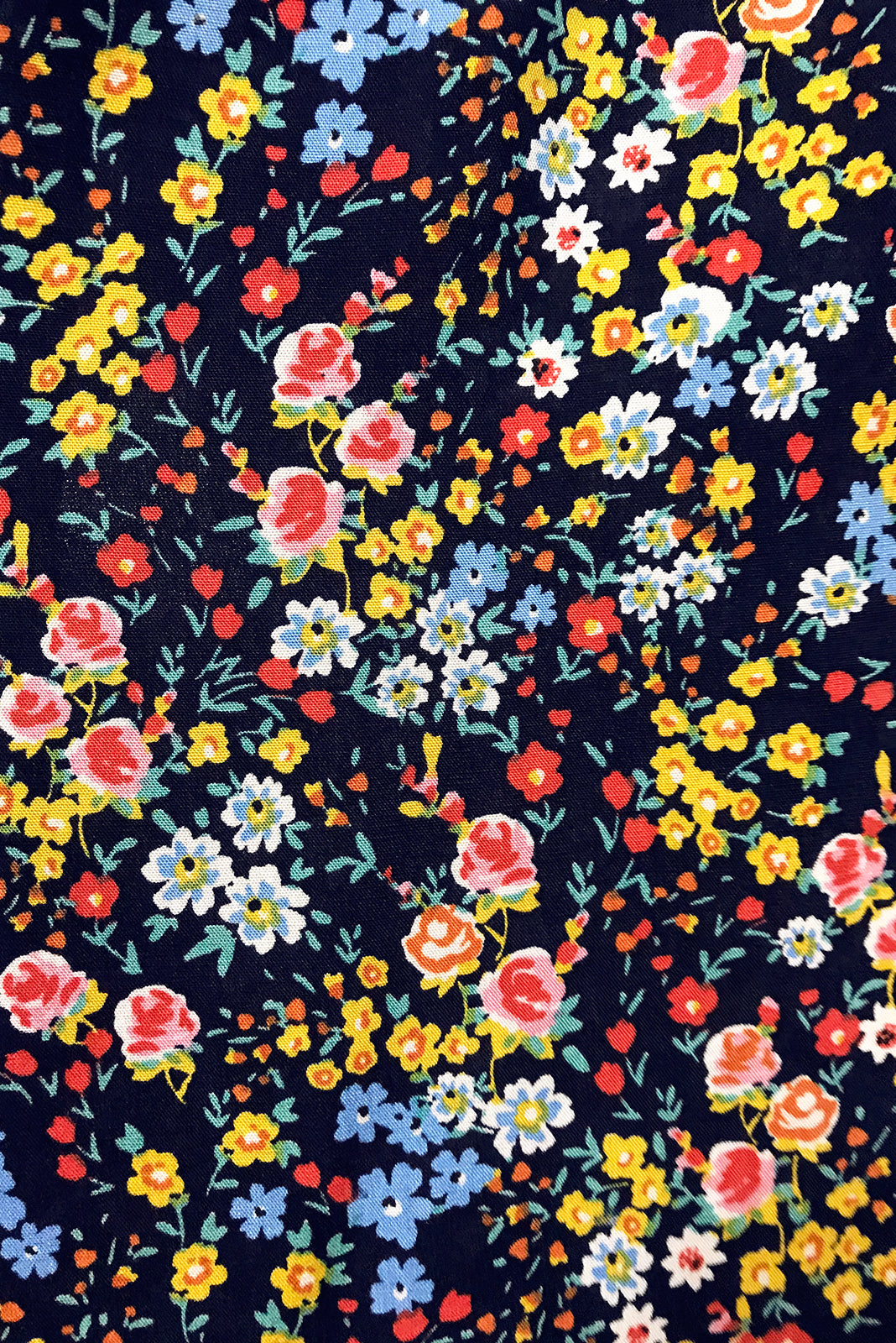 Fabric swatch of Maggie May Ink Picnic Dress featuring 100% rayon in ink base with small, colourful floral print.