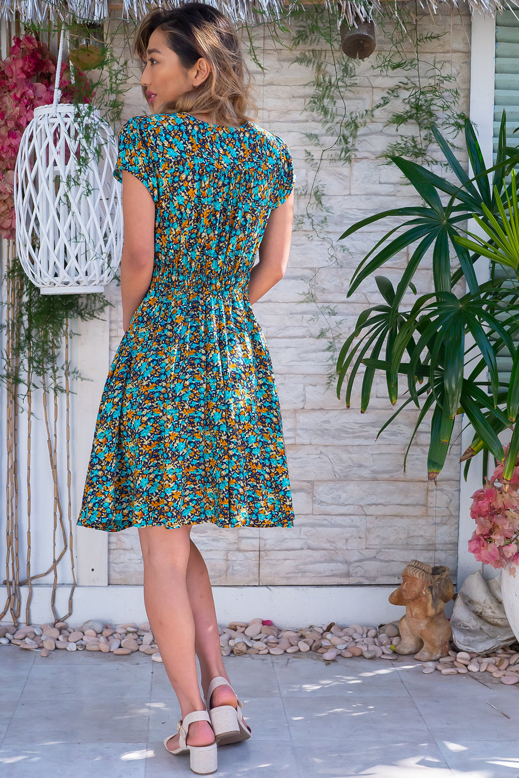 The Maggie May Navy Sprinkles Dress features gathered bust with basque underneath, waist features comfortable elastic shirring at back, deep side pockets, flirty skirt draping from underneath bust and 100% rayon in navy base and multicoloured floral print.