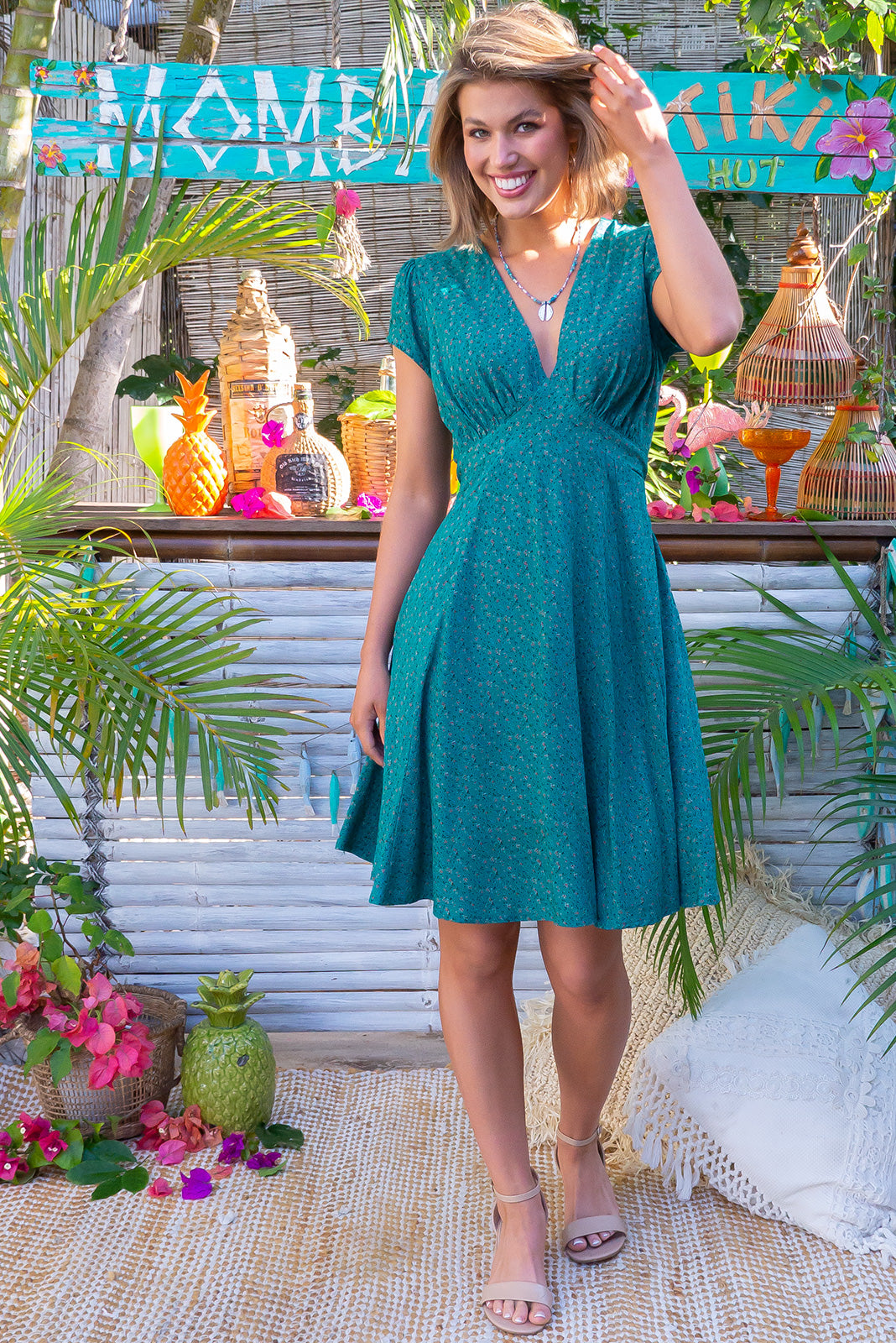 The pretty Maggie May Teal Temptation Dress features gathered bust with basque underneath, waist features comfortable elastic shirring at back, cap sleeves, deep side pocket and 100% rayon in deep teal base print with ditzy print.