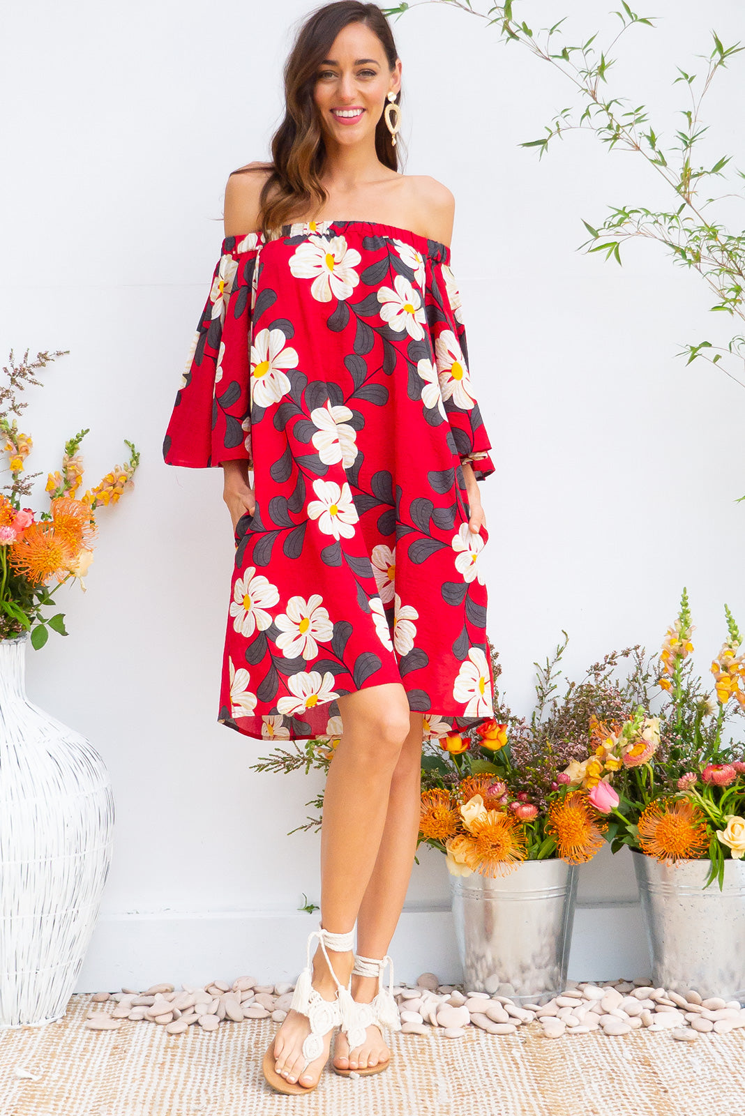 Mai Tai Bird Intense Red Off the shoulder dress in bright red graphic daisy print on woven rayon cotton blend with pockets