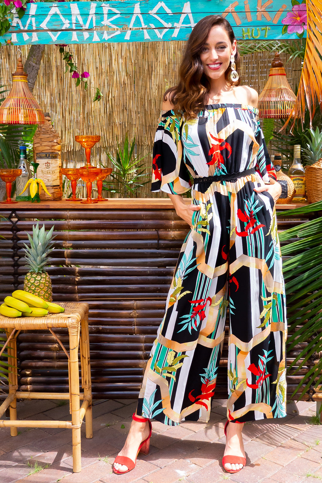 Malibu Wilde Geo Jumpsuit off the shoulder soft fit maxi jumpsuit with an elastic waist in a bright retro inspired geometric and floral print on 100% rayon with side pockets