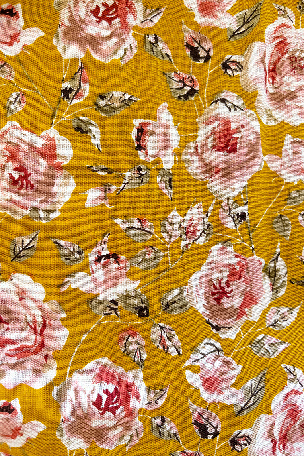 Fabric Swatch of Mariette Golden Roses Dress featuring woven 100% viscose in soft gold base with pale pink rose print print.