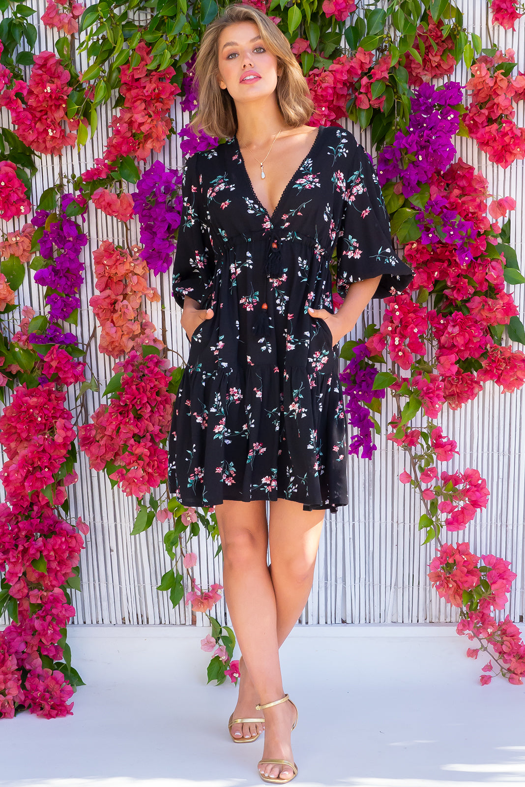 The Sexy dress, Mariette Norton Noir Dress features puff sleeves, side pockets, adjustable drawstring waist and 100% rayon in black base with sweet floral print.