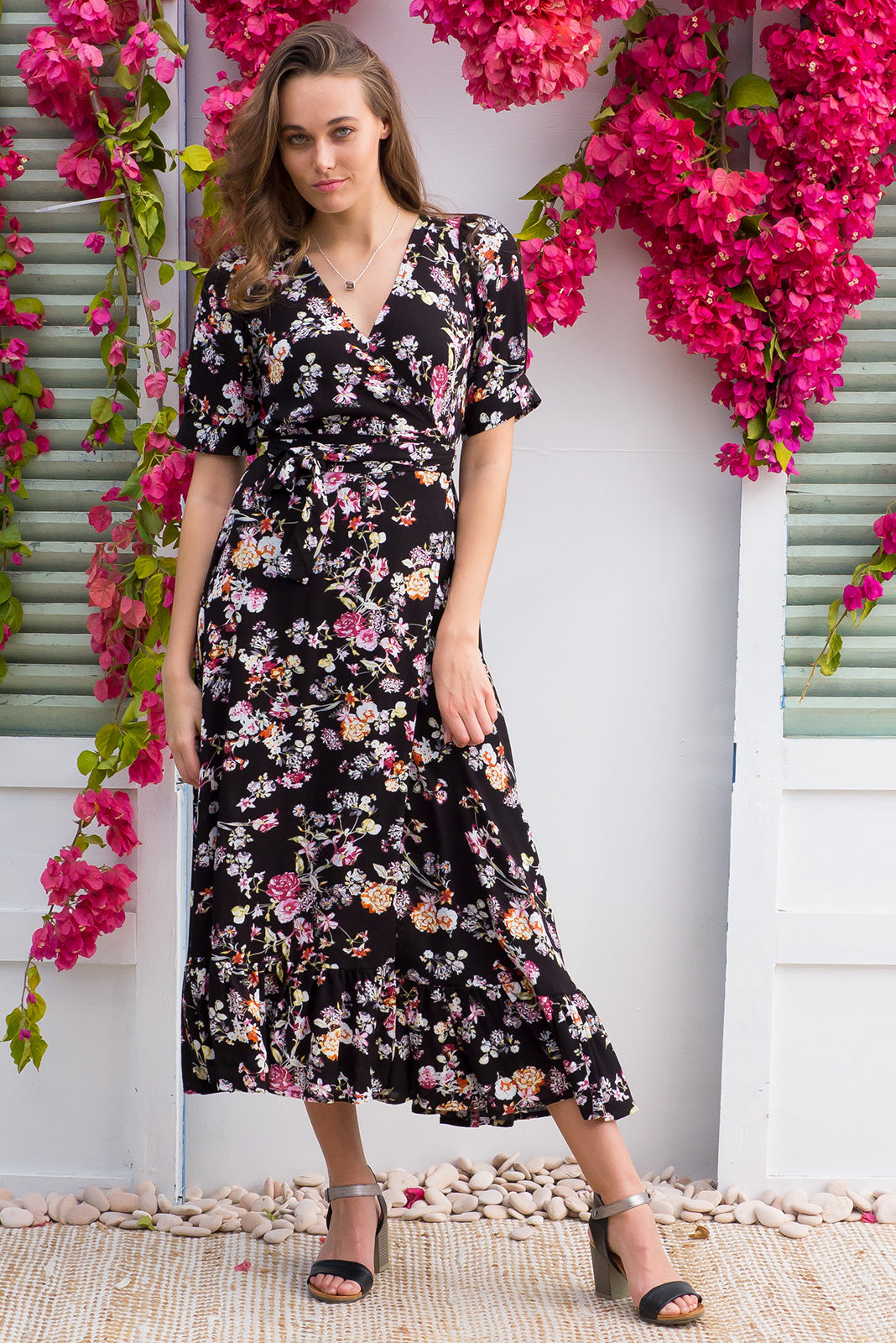 Martinique Secret Garden Maxi Wrap Dress in a 1940's inspired style with cuffed midi sleeves and a delicate hemline frill in black floral on crinkle woven rayon