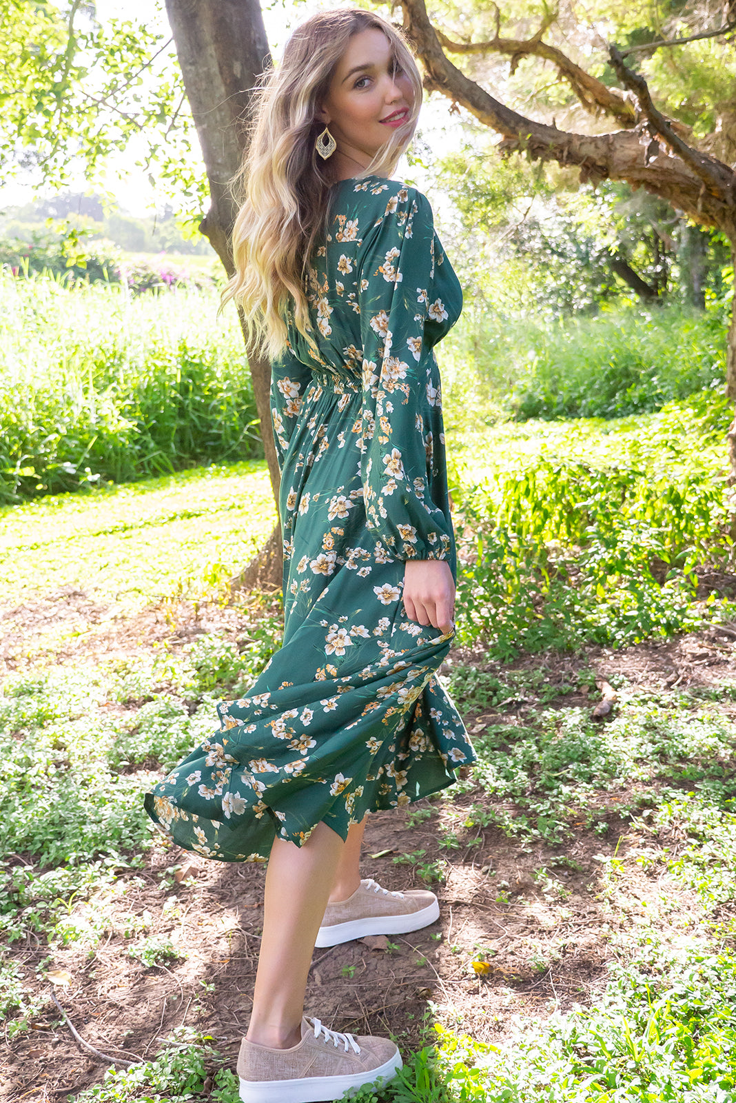 Mayfair Green Iris Maxi dress features a vintage inspired empire line basque with elastic across the back, a full long sleeve with an elasticated cuff, a deep v neck the fabric is made from a soft woven rayon in a soft green floral print
