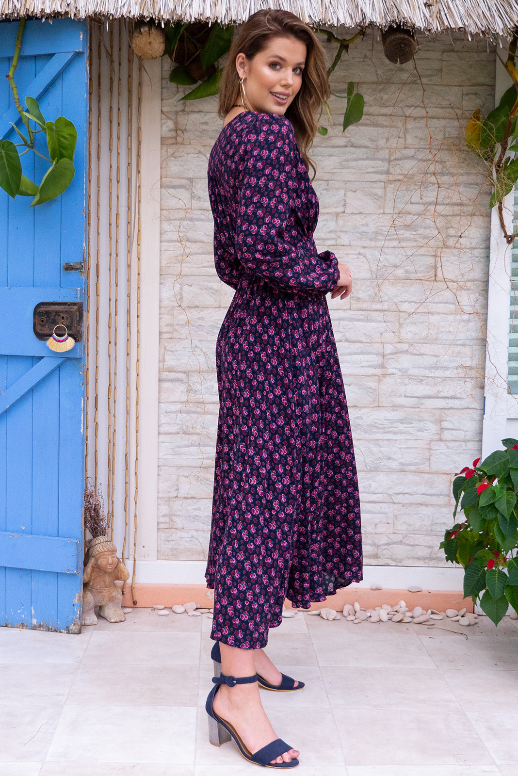 Mayfair Candy Noir Maxi dress features a vintage inspired empire line basque with elastic across the back, a full long sleeve with an elasticated cuff, a deep v neck the fabric is made from a soft woven rayon in a dark purple and pink floral print