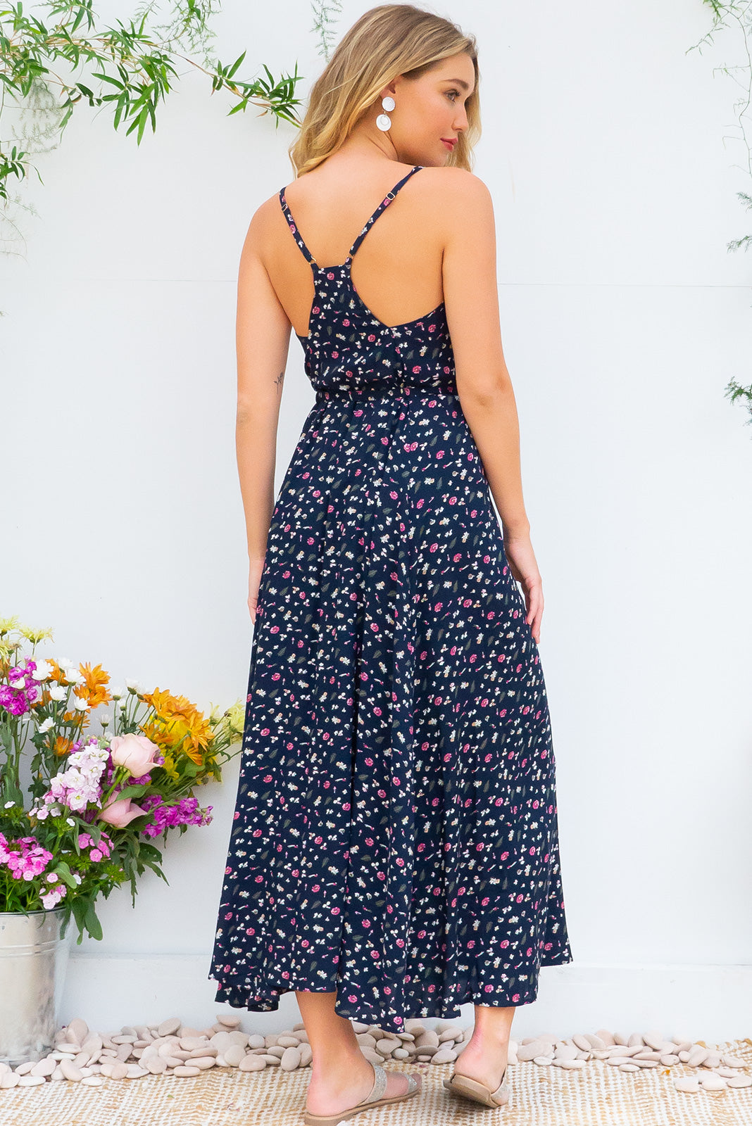 Meilani Cool Navy Maxi Dress in a sexy strappy design featuring a low cut back and self coloured belt