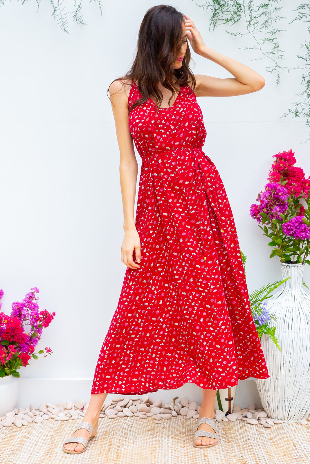 Meilani Red Siren Maxi Dress in a sexy strappy design featuring a low cut back and self coloured belt in a ditzy floral on a cool red base