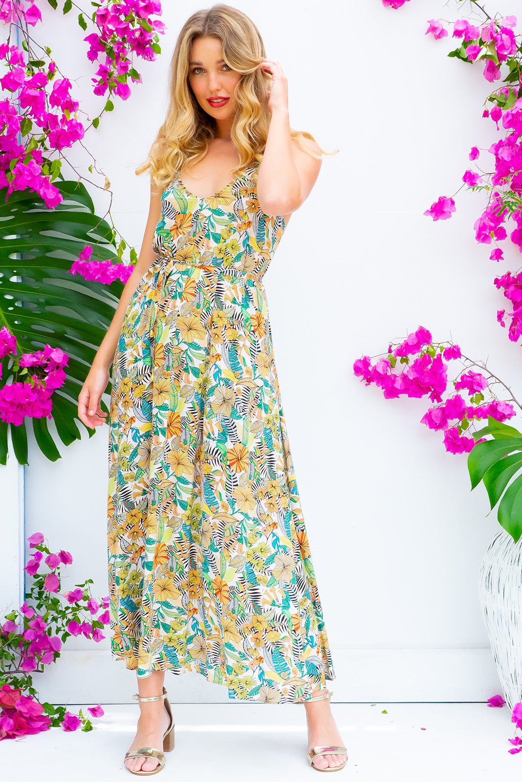 Meilani Green Amore Maxi Dress is a sexy strappy design featuring a low cut back and self coloured belt in a soft woven rayon with a jungle inspired cream and green tonal print