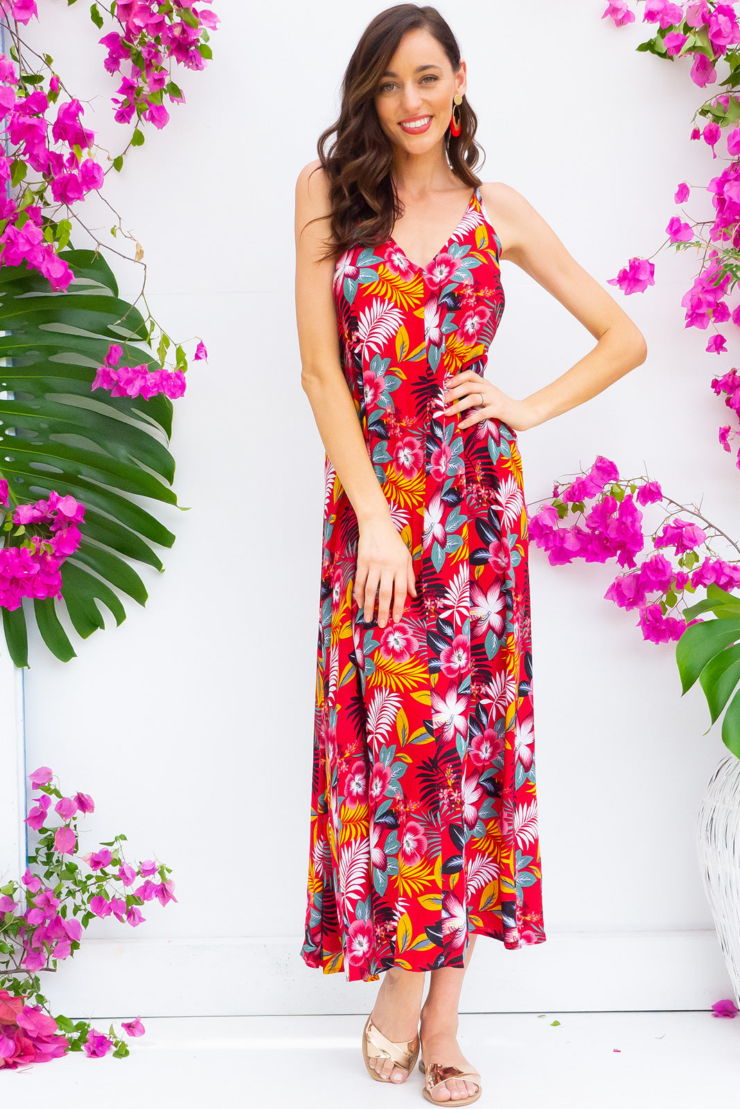 Meilani Red Siren Maxi Dress in a sexy strappy design featuring a low cut back and self coloured belt in a bold tropical inspired botanical print on a cool red base