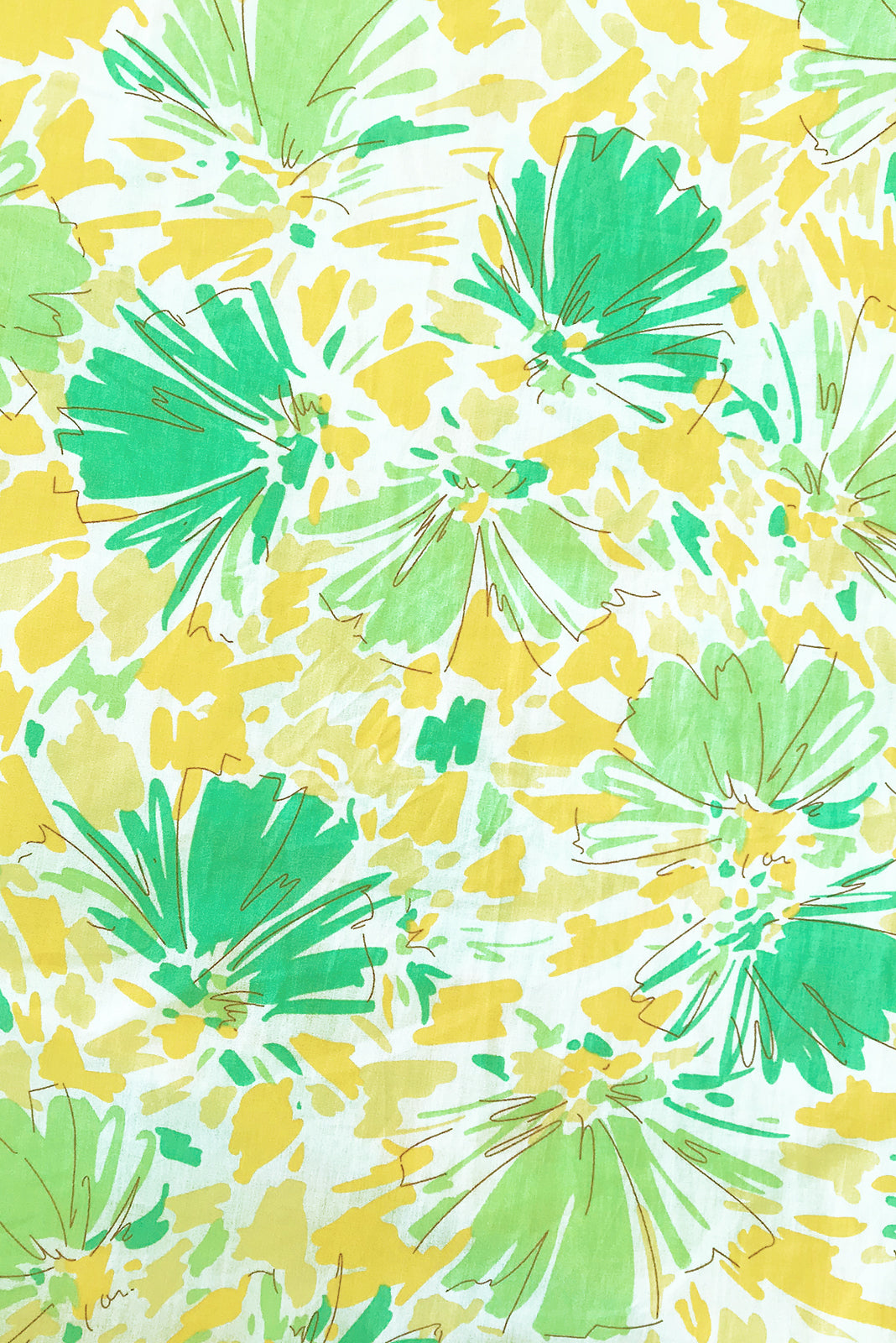 Fabric swatch of Midsummer Lemon and Lime Dress featuring 100% cotton poplin in white base splashed with a bright, yellow and green print.