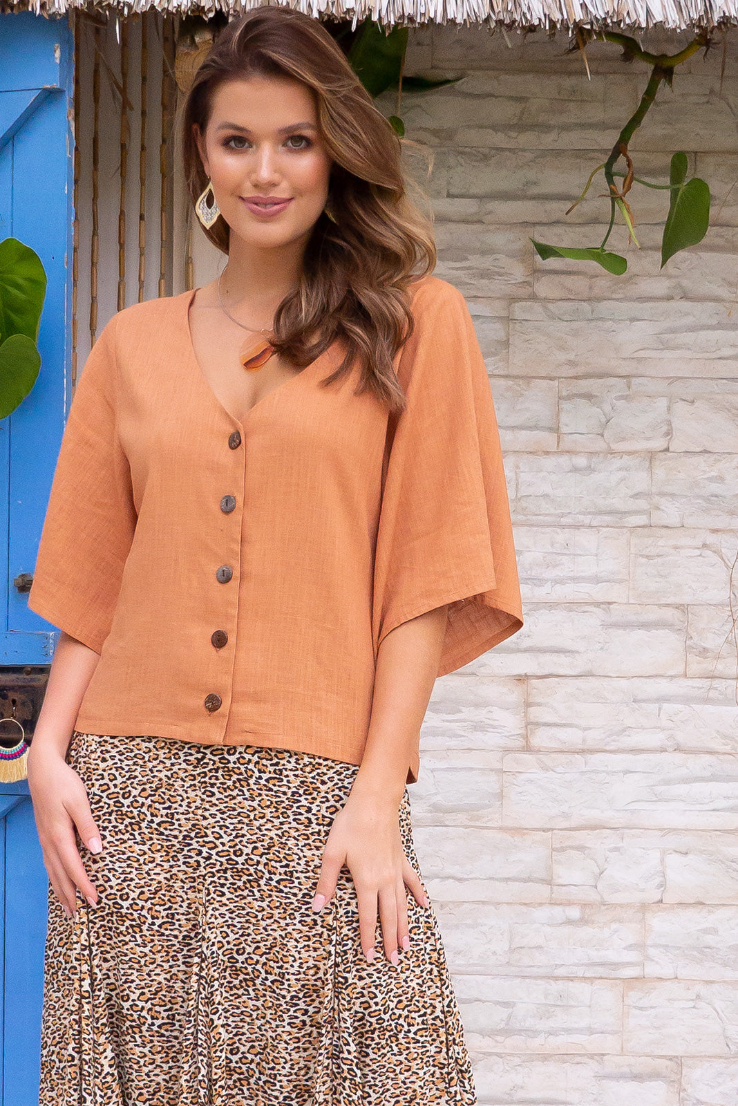 Mika Moccasin Cinnamon linen luxe fabric top features a button front, flattering v neckline and elbow length sleeve, perfect for pairing with maxi skirts for a chic boho romantic style