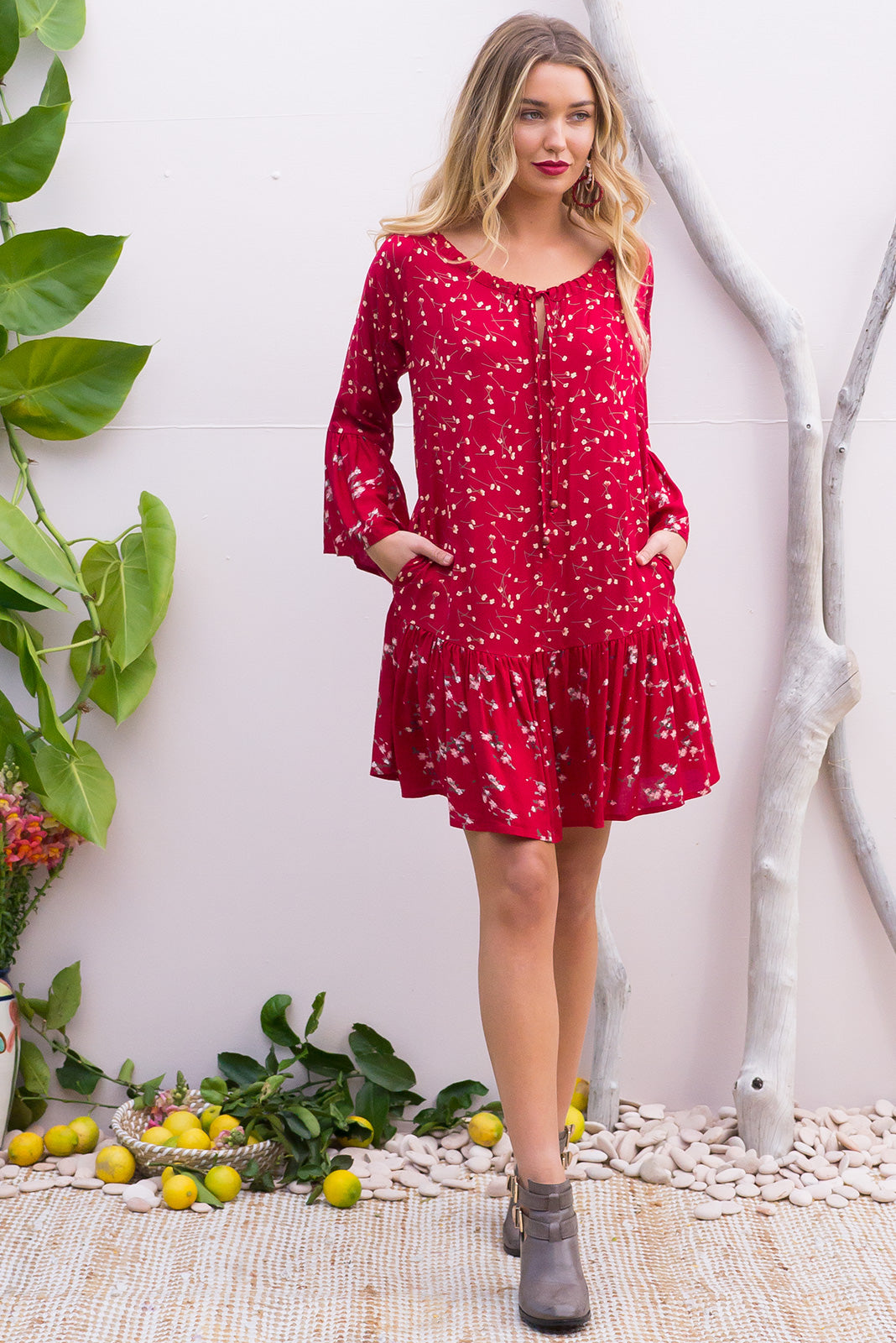 Moon River Ruby Red Dress features a drop waist and 3/4 sleeves with a boho frill and a cord drawstring neck in a intricate boho mix and match vintage print in bold ruby red shades on a soft woven rayon