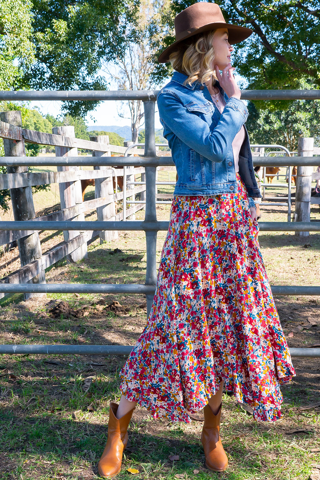 Narah Red Yves Maxi Skirt features elasticated waist, deep side pockets, waved/frill hemline and woven 100% rayon in vibrant multicoloured confetti floral print.