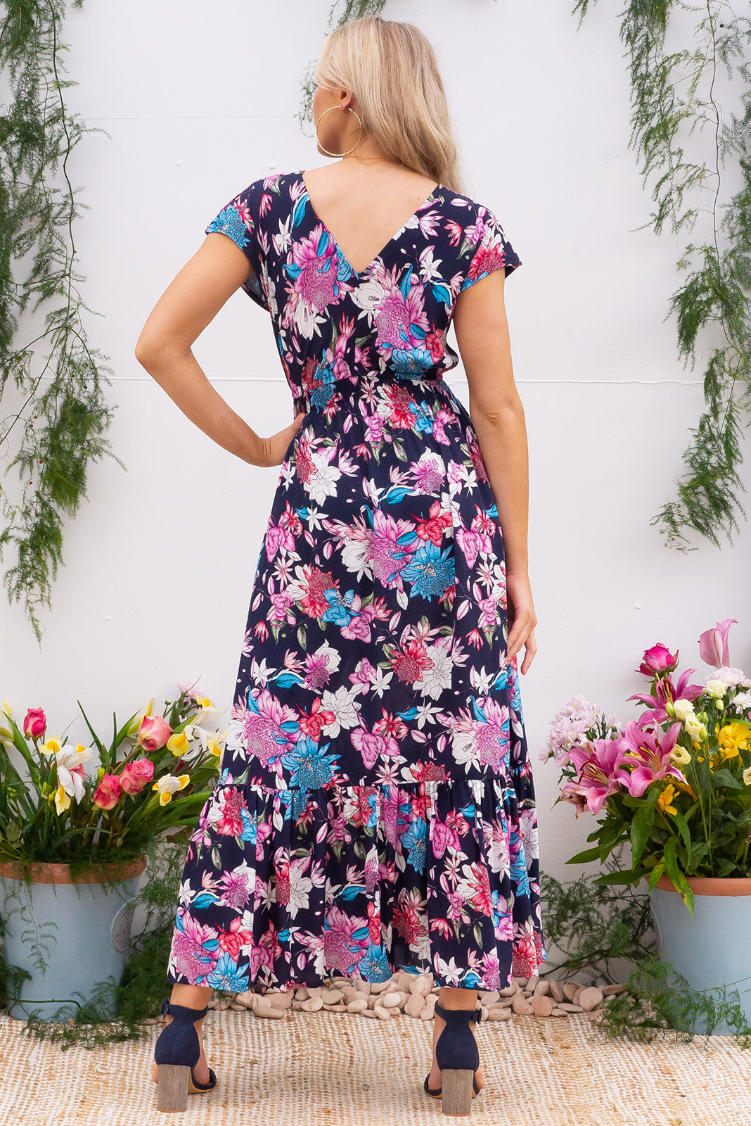 Nellie Arbour Ink Maxi Dress Maxi dress features elasticated empire line with a cap sleeve and deep v neck the fabric is a soft woven rayon in a bright navy based floral print