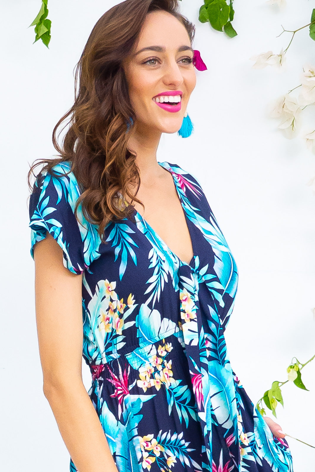 Nellie Azure Leaves Maxi Dress Maxi dress features elasticated empire line with a cap sleeve and deep v neck the fabric is a soft woven rayon in a bright navy based floral print