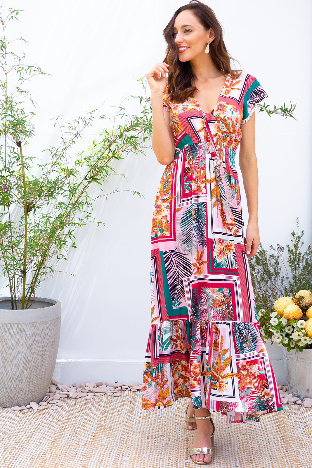 Nellie Cartagena Red Maxi Dress Maxi dress features elasticated empire line with a cap sleeve and deep v neck the fabric is a soft woven rayon in retro inspired resort wear print based