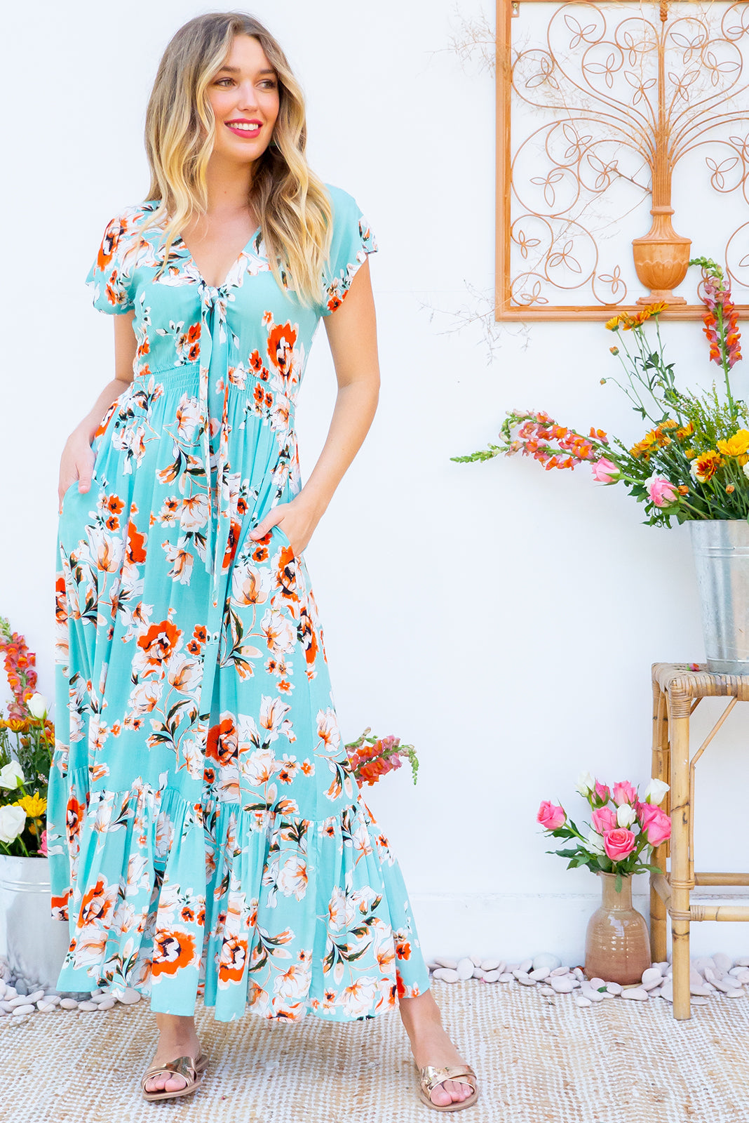 Nellie Green Mist Maxi Dress Maxi dress features elasticated empire line with a cap sleeve and deep v neck the fabric is a soft woven rayon in a celadon green based floral print