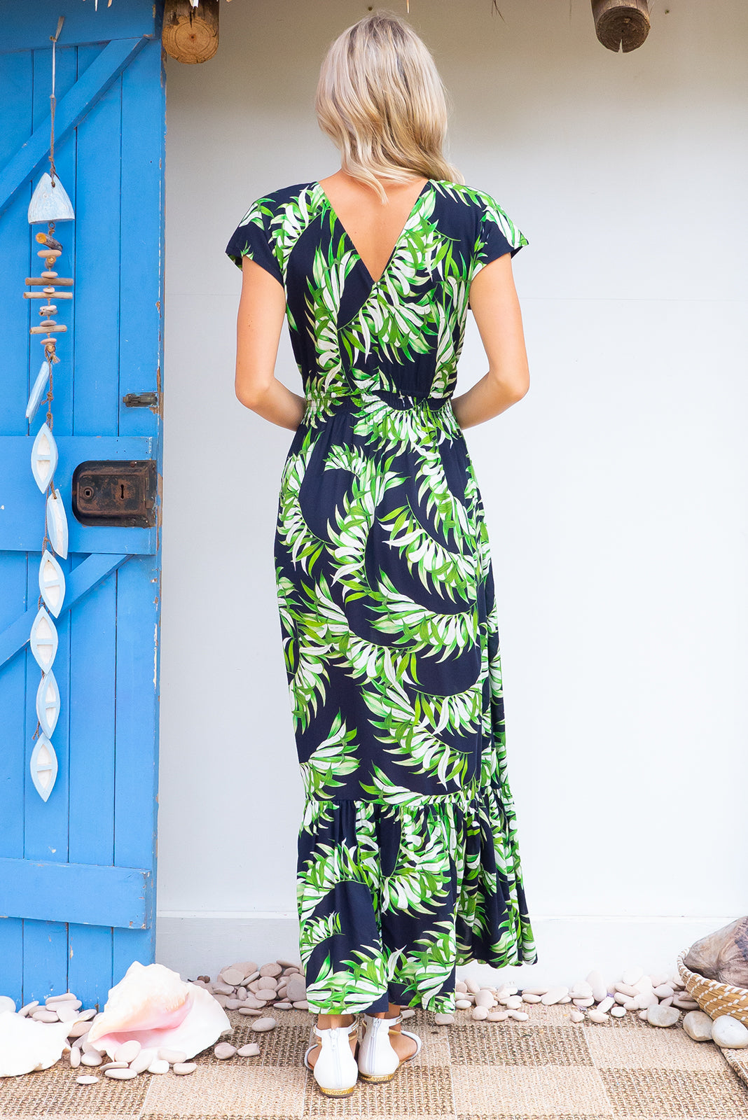 Nellie Palms Maxi Dress Maxi dress features elasticated empire line with a cap sleeve and deep v neck the fabric is a soft woven rayon in a bright navy based floral print
