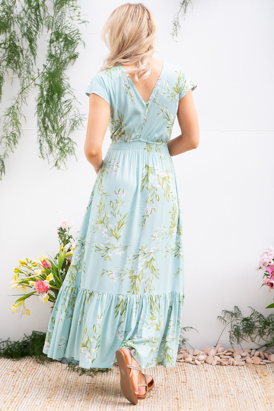 Nellie Snowdrop Aqua Maxi Dress Maxi dress features elasticated empire line with a cap sleeve and deep v neck the fabric is a soft woven rayon in a celadon green based floral print