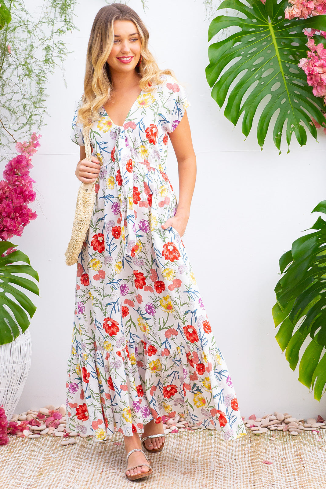 Nellie Sweet Summer Maxi Dress Maxi dress features elasticated empire line with a cap sleeve and deep v neck the fabric is a soft woven rayon in a white based floral print