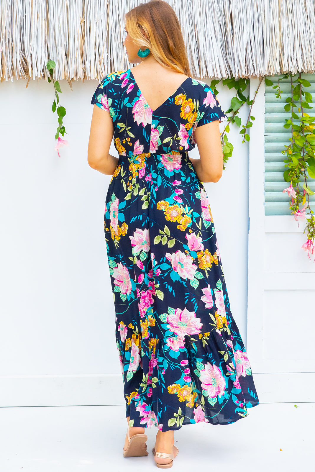 Nellie Waterlilly Navy Maxi Dress Maxi dress features elasticated empire line with a cap sleeve and deep v neck the fabric is a soft woven rayon in a bright navy based tropical inspired floral print