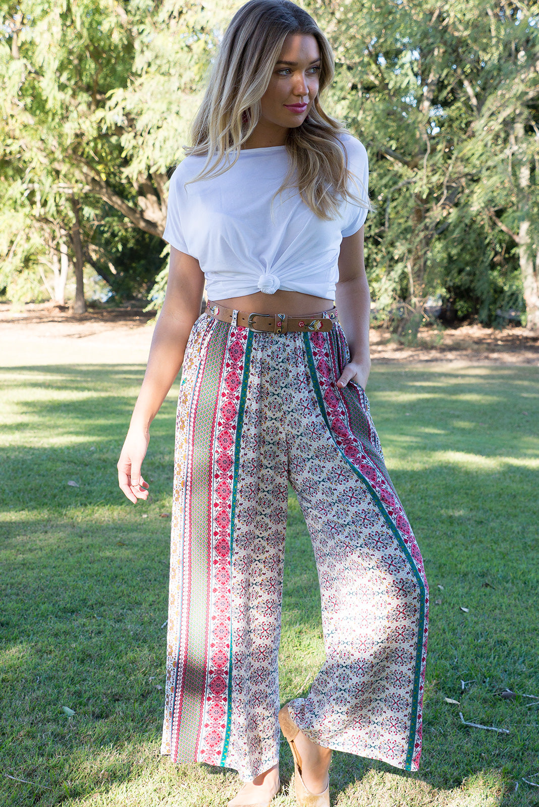 Nomad Border Trail pants with an elastic waist, wide leg and deep pockets comes in a bohemian and eastern inspired stripe on a crinkle texture rayon