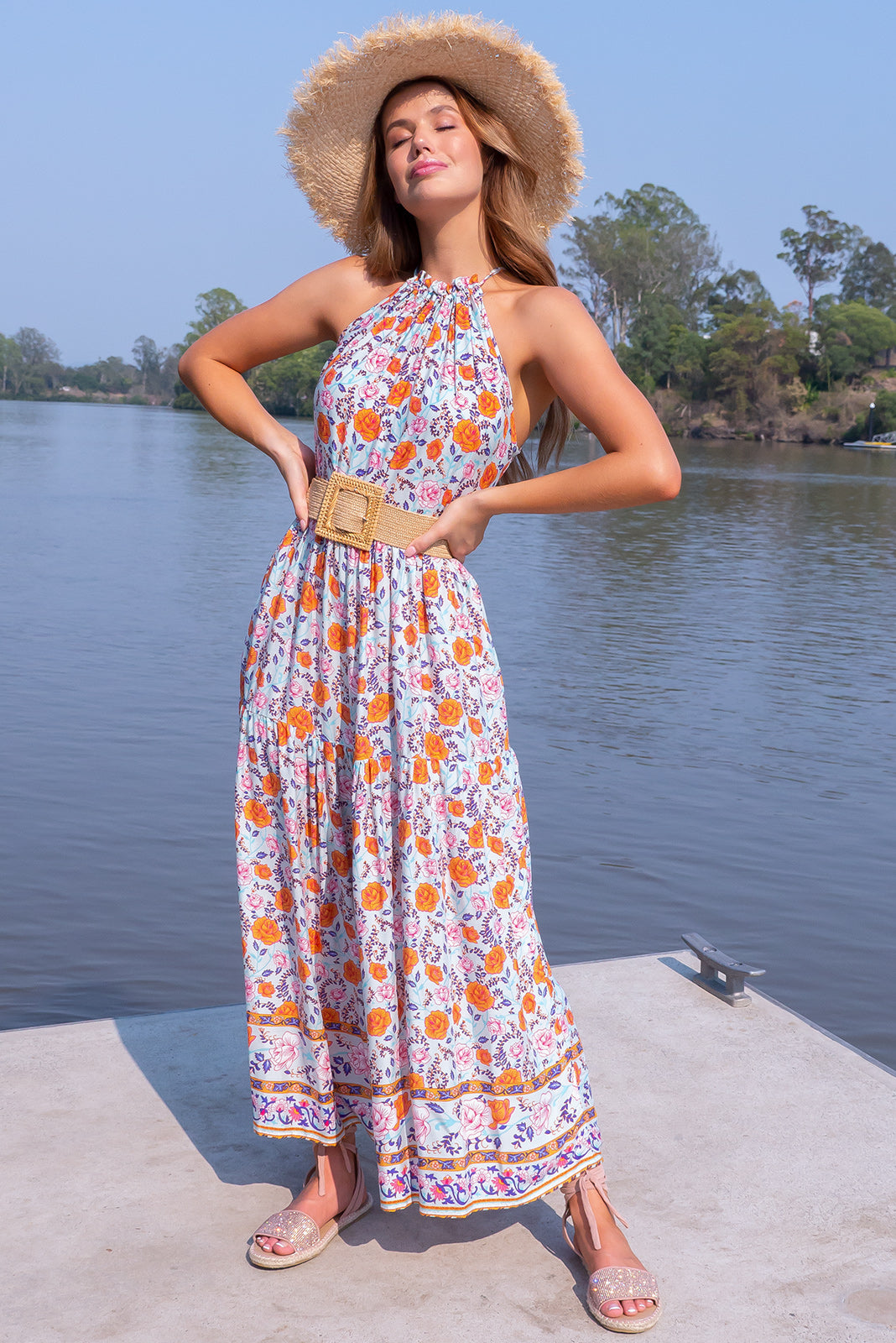 Noosa French Mint Maxi Dress, bright floral maxi dress features halter neck, adjustable string neckline, tiered skirt, side pockets, floral design featuring bright orange, purple, blue and fuchsia and complimentary border pattern in woven 100% rayon.
