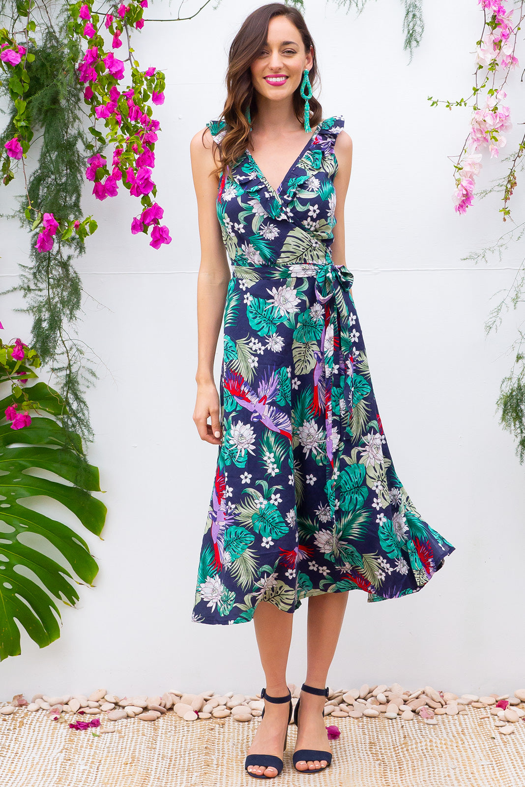 Pablo Amazonian Navy Midi Wrap Dress features a flattering wrap around shape, sleeveless bodice with a frill and comes in a bright dark navy based tropical print on cotton rayon blend
