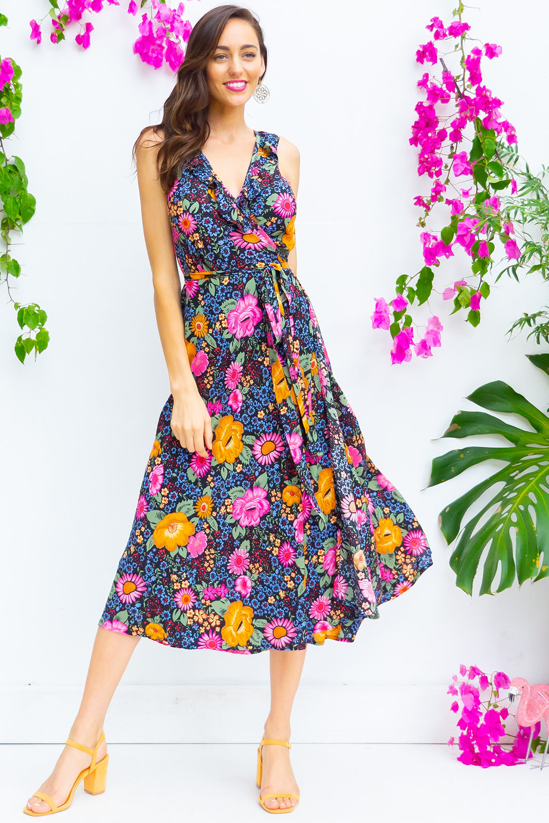 Pablo Night Blooms Midi Wrap Dress features a flattering wrap around shape, sleeveless bodice with a frill and comes in a bright dark floral print with a black base on 100% rayon