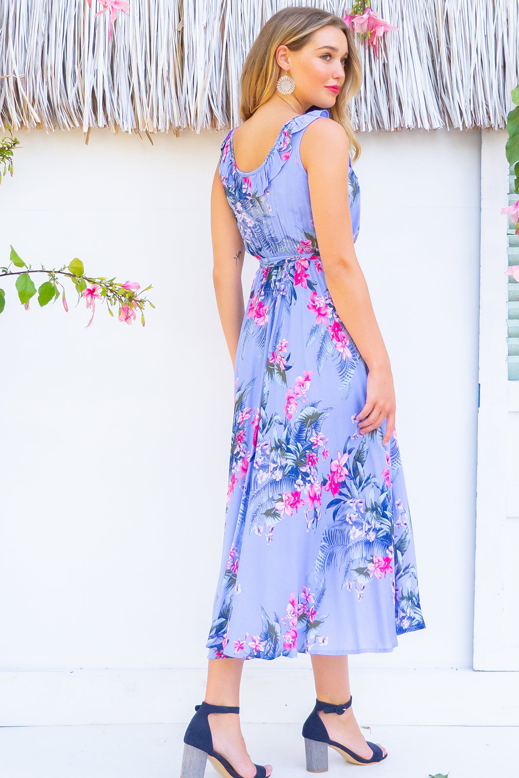Pablo Periwinkle blue Wrap Dress features a flattering wrap around shape, sleeveless bodice with a frill and comes in a bright periwinkle blue based tropical floral print on rayon woven fabric