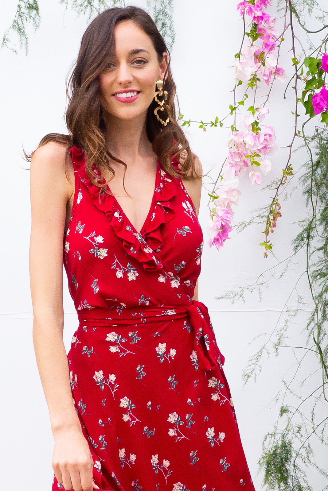 Pablo Red Fling Midi Wrap Dress features a flattering wrap around shape, sleeveless bodice with a frill and comes in a rich warm red with a small floral print on 100% rayon