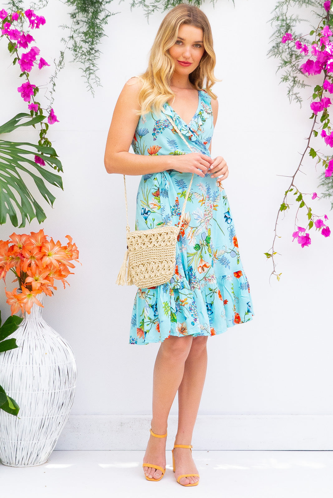 Paloma Aquamarine Wrap Dress features a flattering wrap around shape, sleeveless bodice with a frill and comes in bright aquamarine blue floral print woven rayon