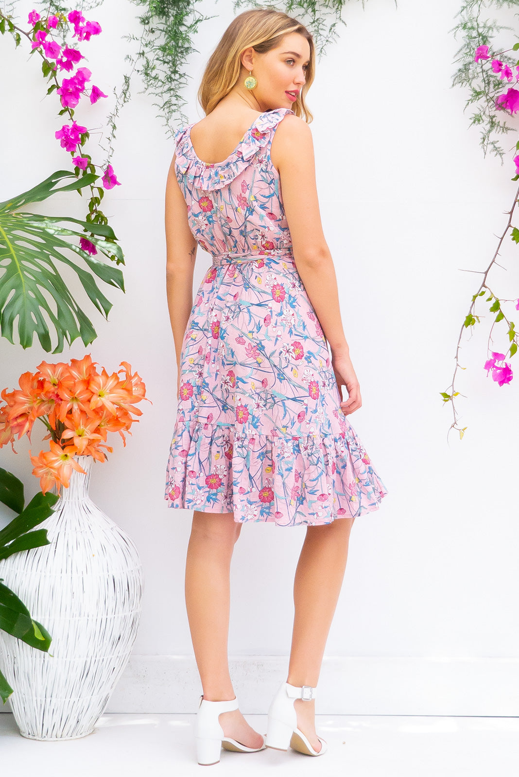 Paloma Pink Le Park Wrap Dress features a flattering wrap around shape, sleeveless bodice with a frill and comes in a cool toned petal pink floral print a cotton rayon blend