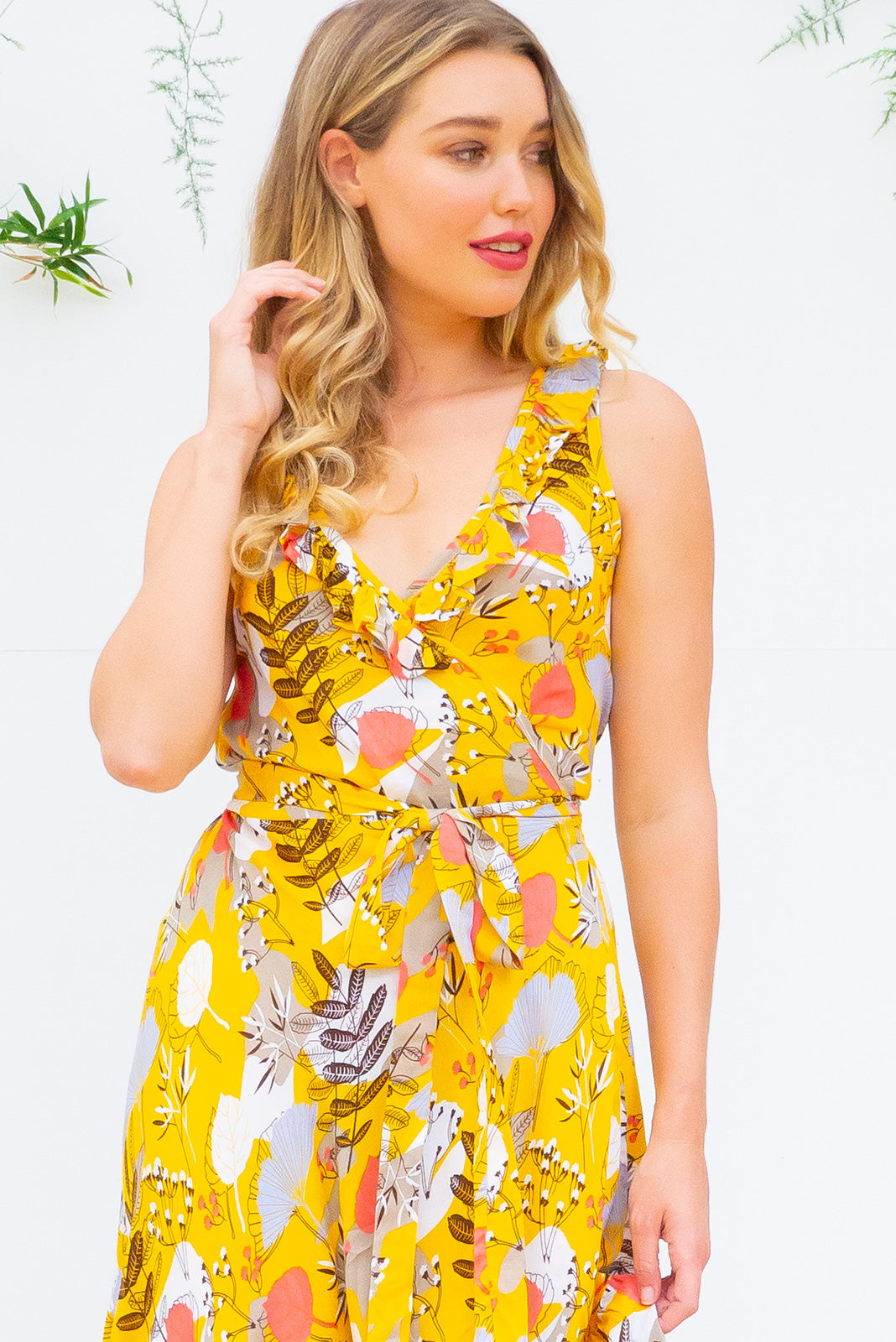 Paloma Yellow Vintage Wrap Dress features a flattering wrap around shape, sleeveless bodice with a frill and comes in bright golden yellow vintage inspired floral print woven rayon