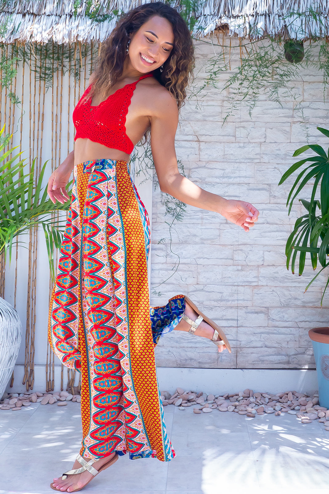 The Parakeet Circus Stripes Pants are comfortable wide legs pants featuring slip on design, belt loops with coconut button detail, side pockets and 100% viscose in bright and retro stripe print.