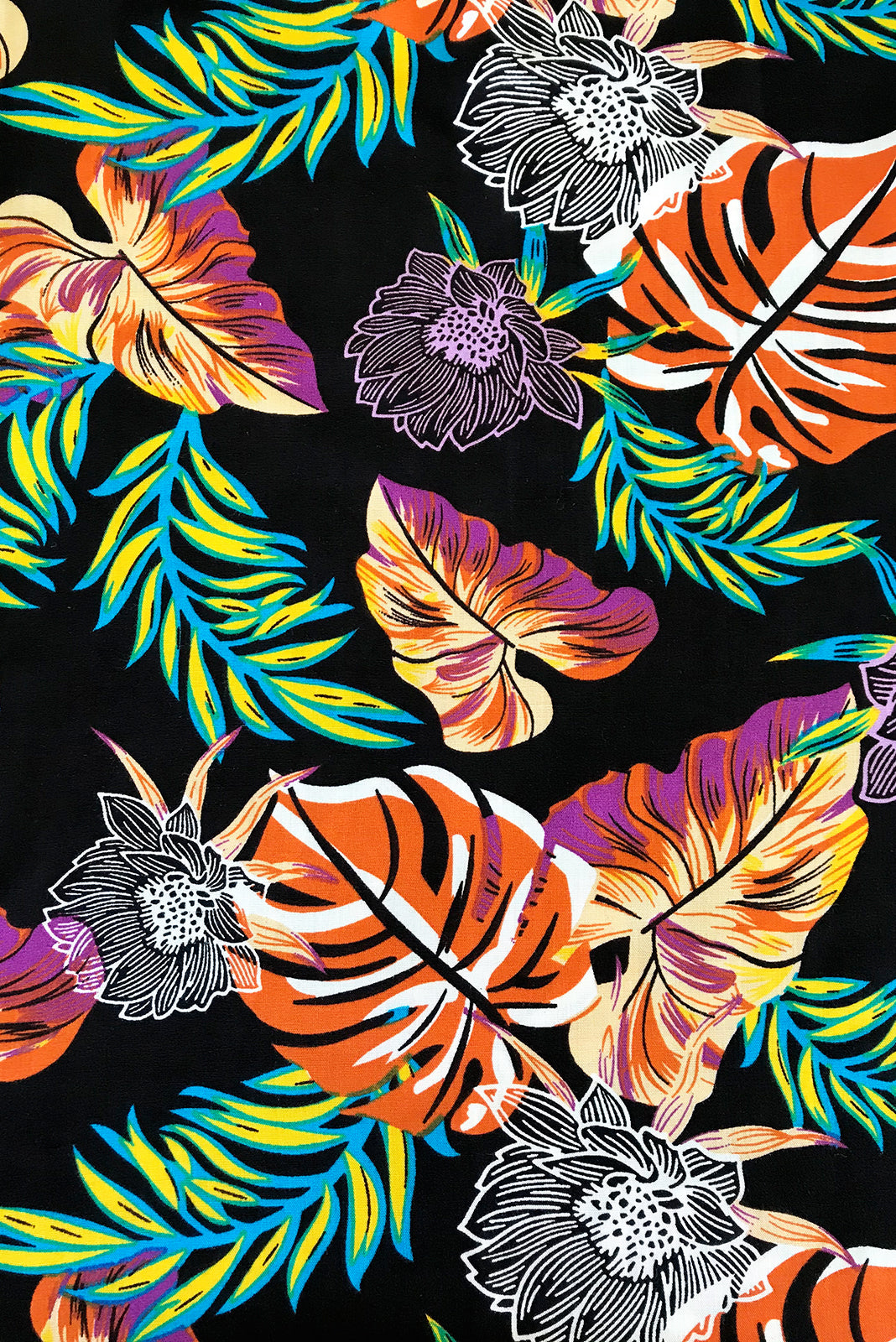 Fabric Swatch of Parakeet Jungle Flowers Pants featuring 100% viscose in black base with vibrant jungle leaf print,