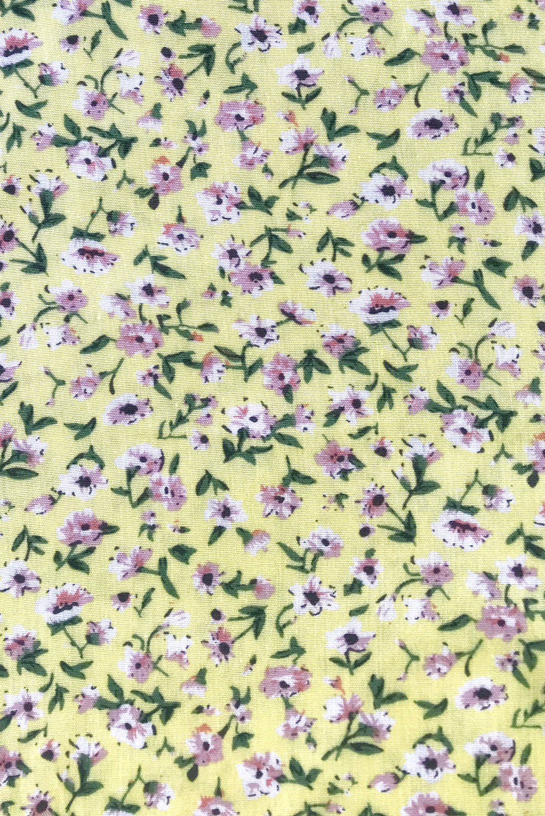Fabric swatch of Peggy Canary Yellow Dress featuring 100% viscose in yellow base with ditzy floral print.