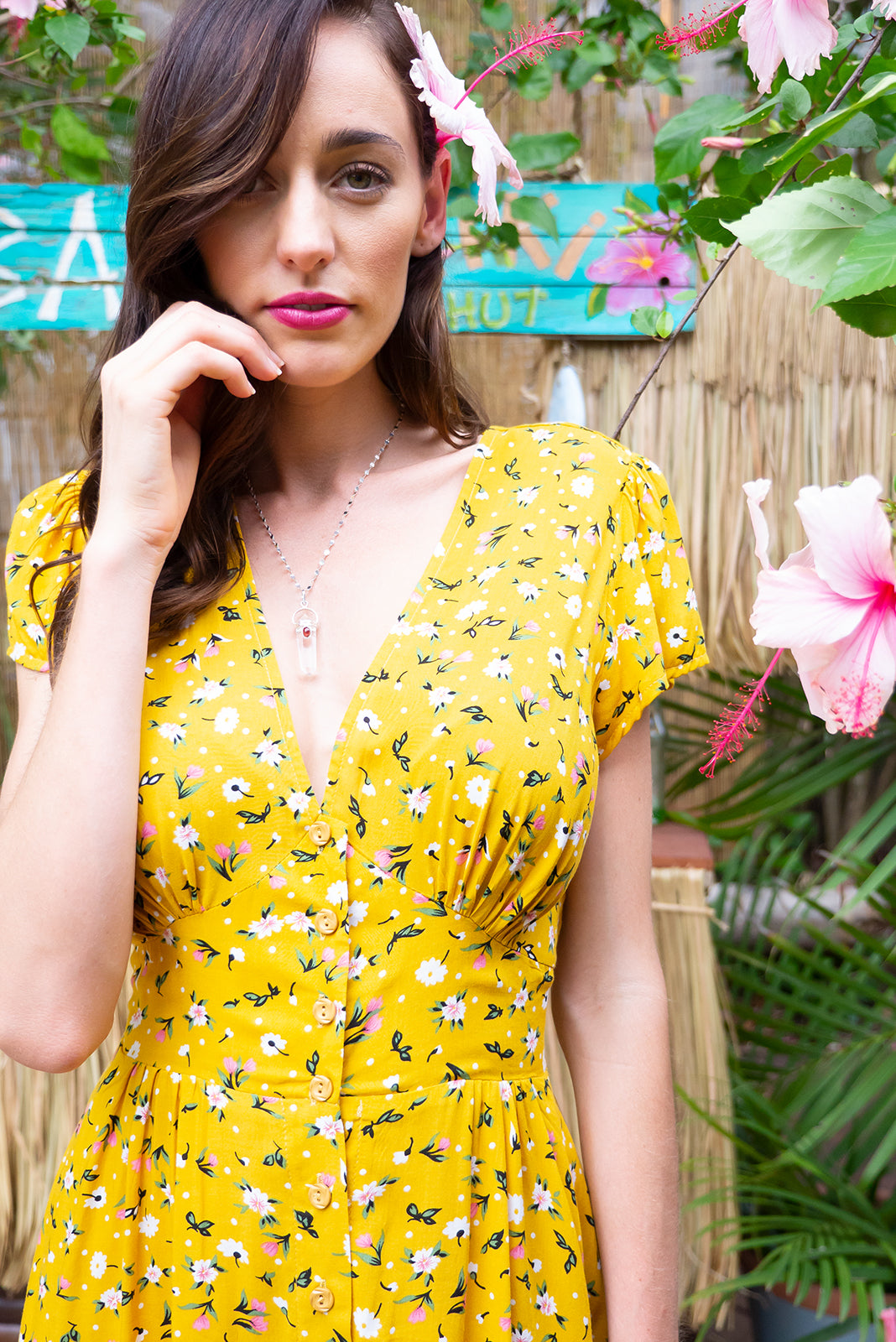 Peggy Avalon Yellow mini dress features a vintage inspired fitted basque waist and elasticated waist with a cap sleeve, deep v neck and a functional button front the fabric is a soft woven rayon in a warm golden yellow floral print
