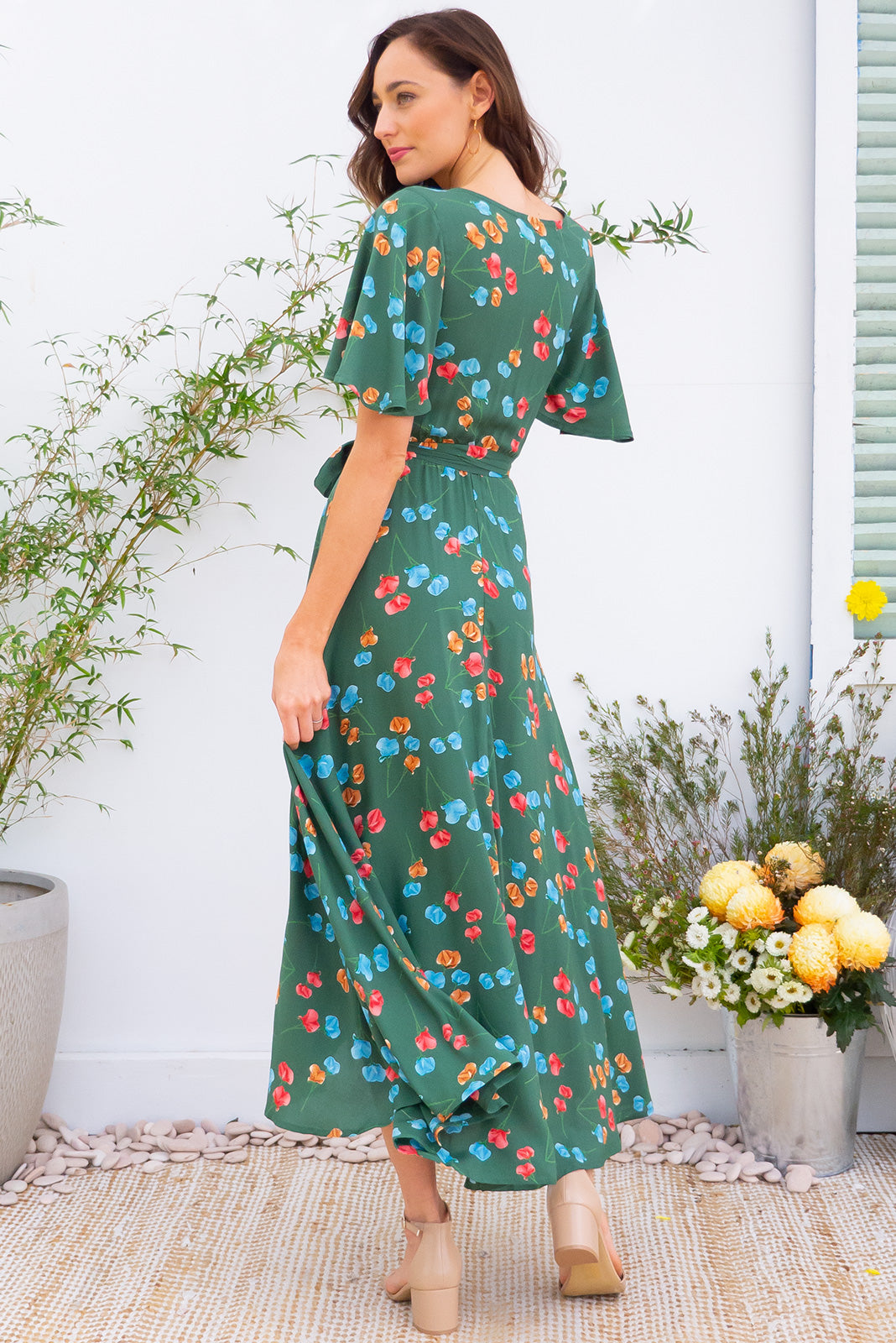 Penny Green Poppies Maxi Wrap dress with flutter sleeves in a leaf green with a poppy floral inspired print on 100% rayon