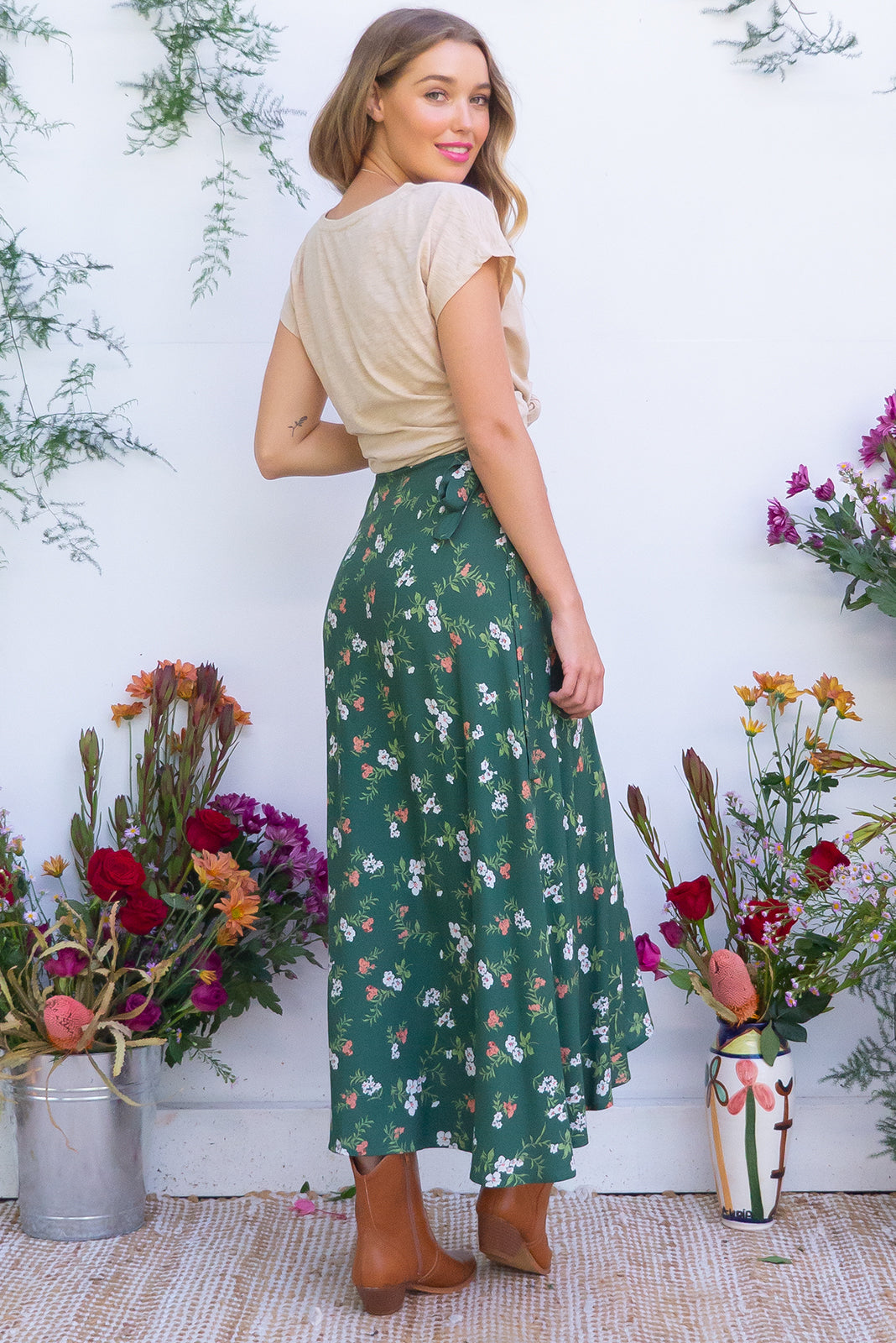 Penny Lane Floral Green Patches Maxi Wrap Skirt with an adjustable wrap around waist and waterfall hemline in a soft woven rayon with a soft green ditzy floral print