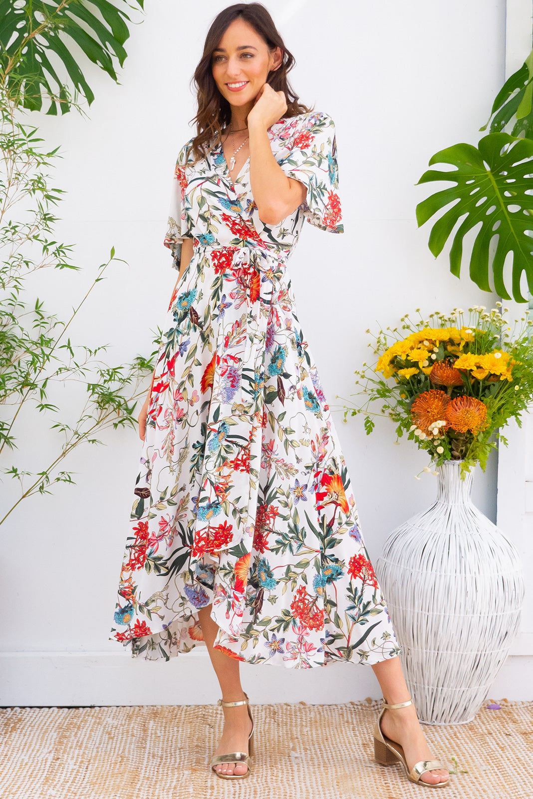 Penny Summer Fields White Maxi Wrap dress with flutter sleeves in a crisp white and multicoloured botanical inspired floral print